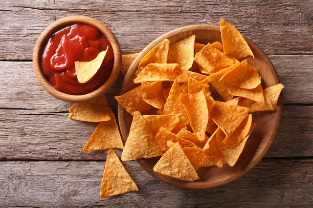 Nachos corn chips with spicy sauce. Horizontal top view