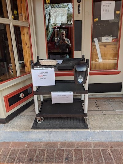 The to-go pick-up table outside Chavas Mexican Restaurant